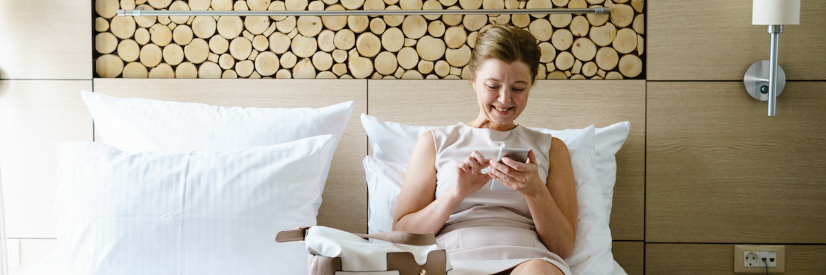Happy woman in hotel room