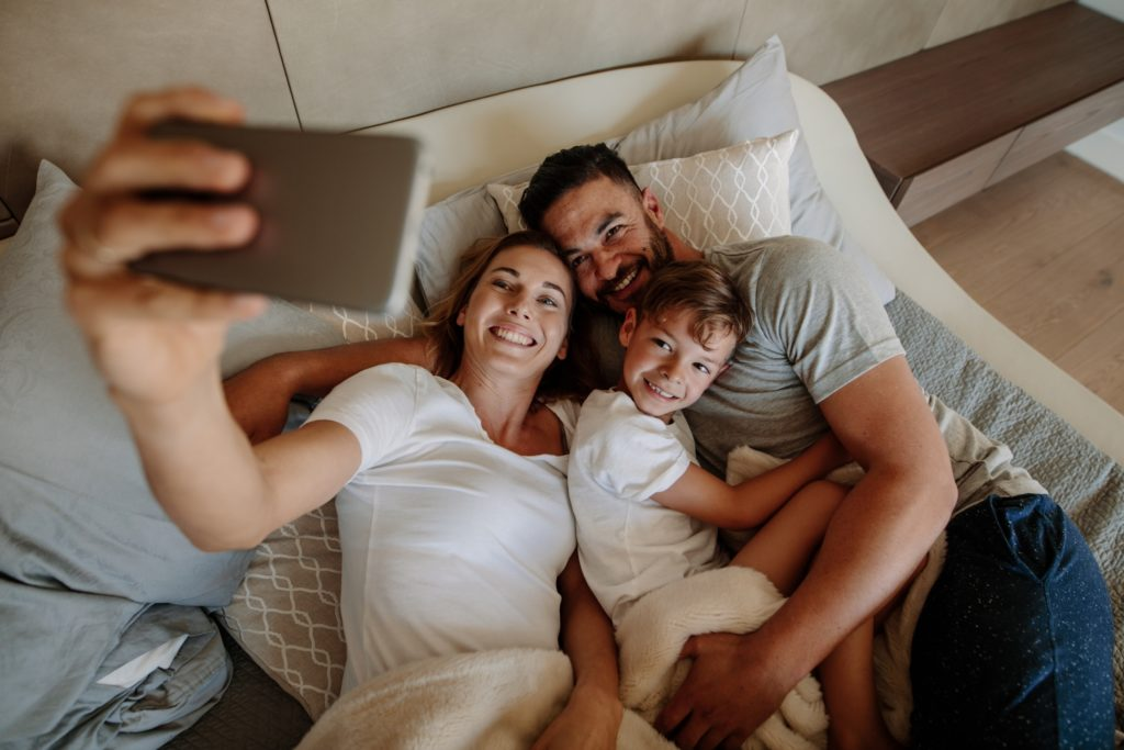 Family Taking a Selfie at a Hotel
