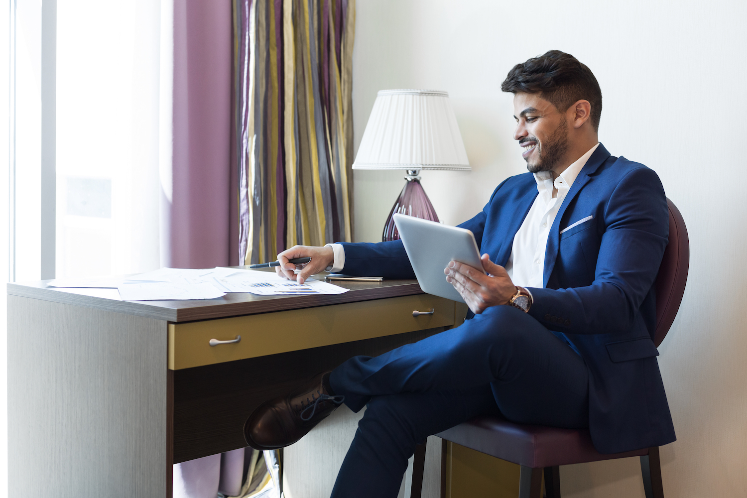 Businessman Working in a Hotel Room