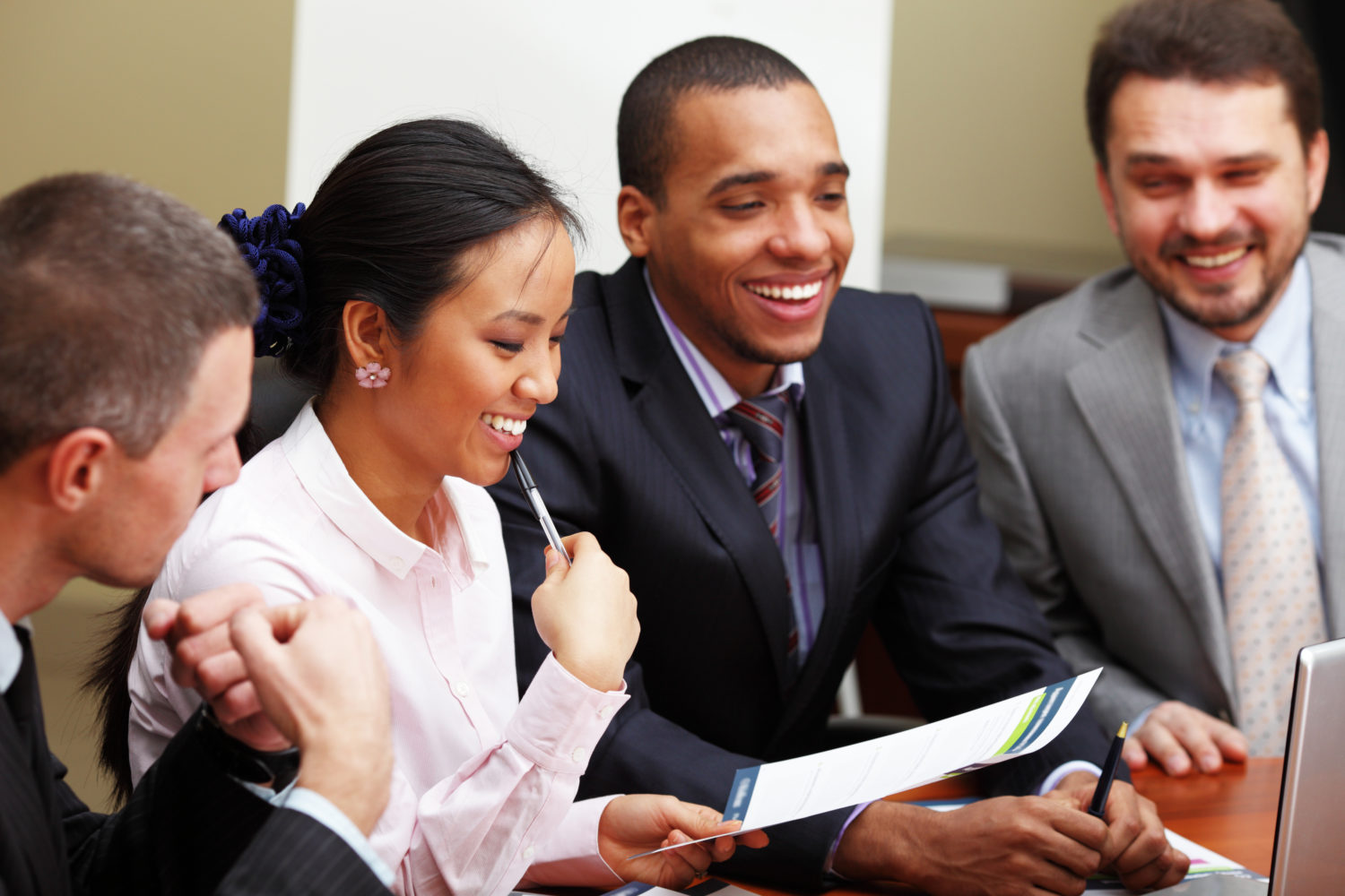 Diverse group of employees mid-discussion
