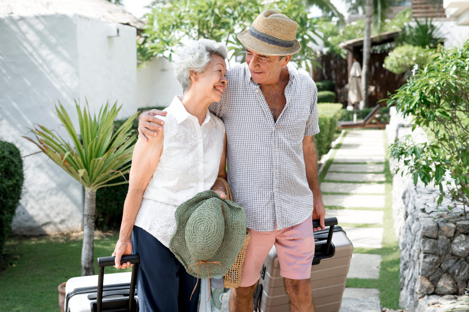 senior couple walking side by side at hotel