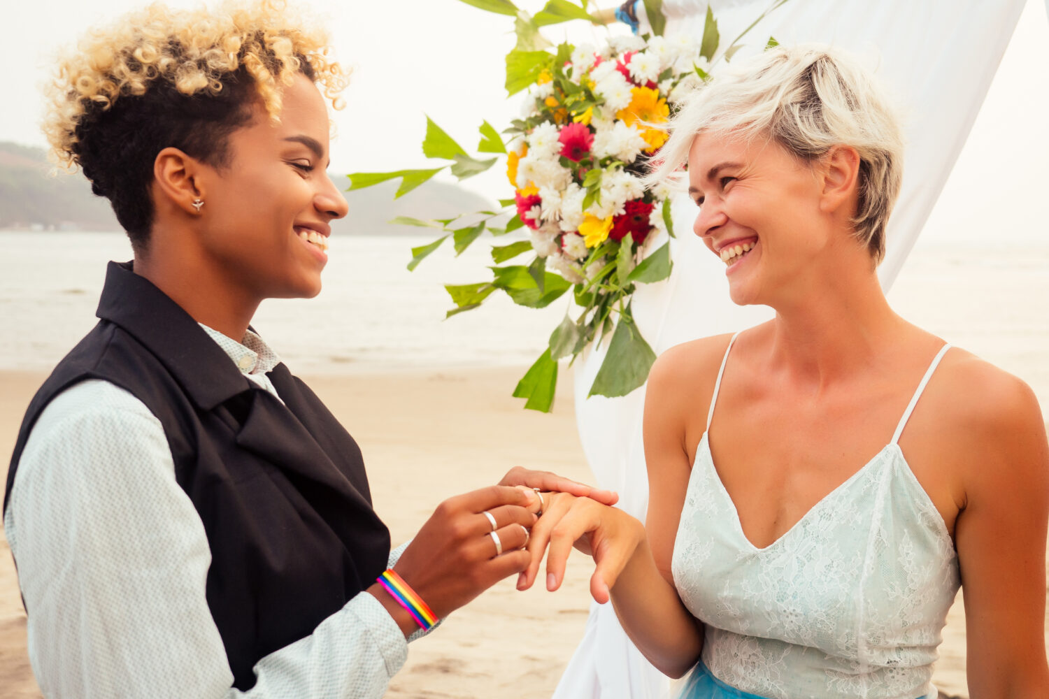 african american woman putting a ring on her girlfriend