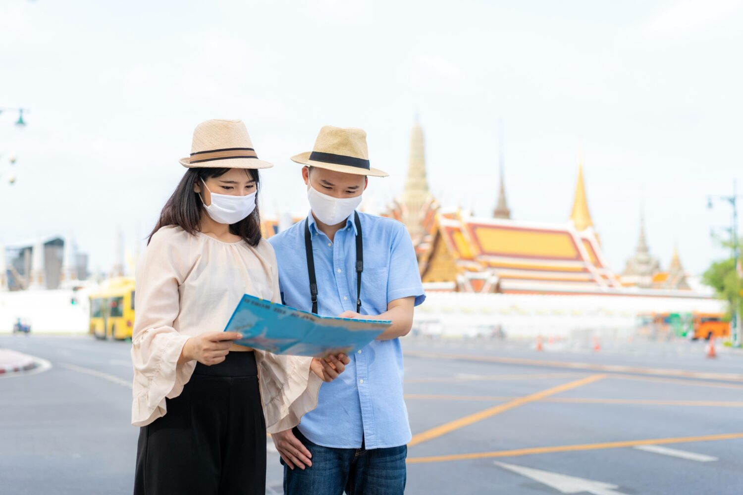 couple sharing a map while masked